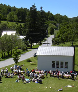 Town picnic at schoolhouse